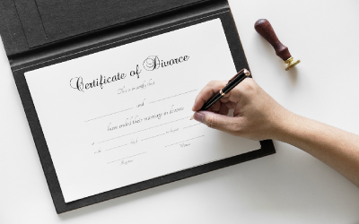 Image of a certificate of divorce being signed